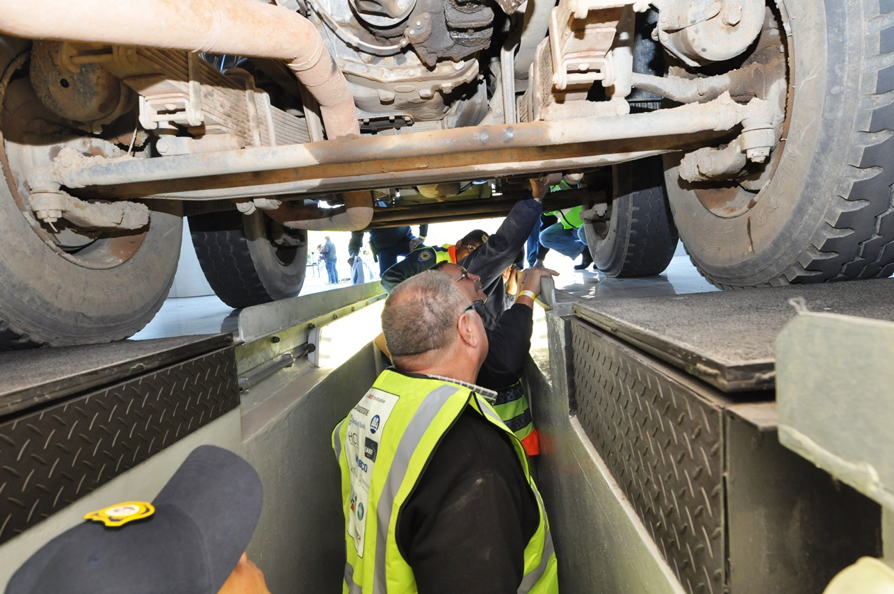 Traffic Officers conduct undercarriage inspections.
