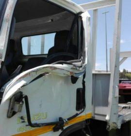 Stationary bakkie rear-ended by a truck on the R24 East after Edenvale
