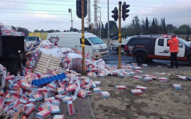 Grade 3 English workbooks scattered in truck rollover