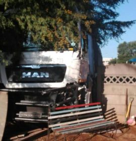 Truck crashes into vehicle and residential fence in Klopperpark