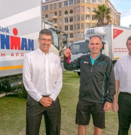 Duncan Young (left), Isuzu Truck Centre Port Elizabeth Dealer Principal (left) hands over truck keys to Paul Wolff, IRONMAN Africa's Director of Operations. With them is Craig Uren, Isuzu Motors South Africa Executive Officer, Sales, Service and Marketing.
