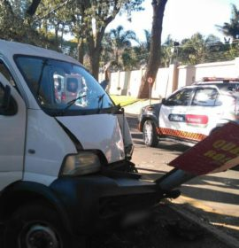 Truck collides with motor vehicle and street pole in Houghton