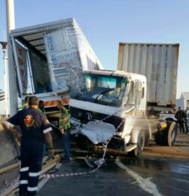 Man seriously injured when crushed between two trucks
