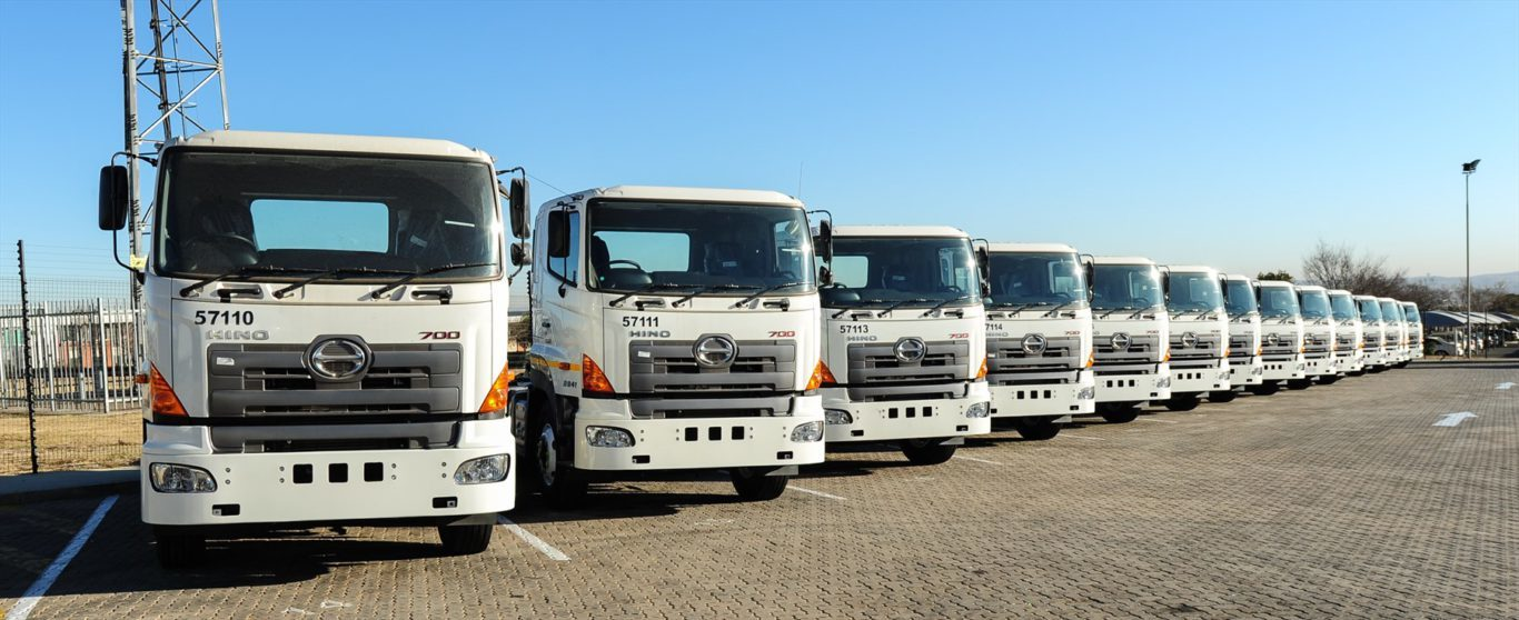 a-batch-of-new-hino-700-series-trucks-being-delivered-to-the-shoprite-depot-by-hino-midrand_1800x1800
