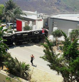 Truck carrying electrical boxes overturns in Bassonia