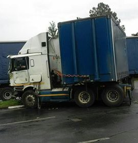 A jack-knifed truck collides with another truck, Alberton