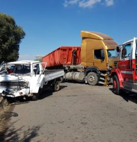 Two trucks collide leaving man critical.