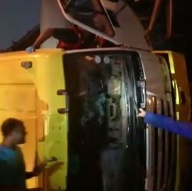 Trapped Driver Freed From Overturned Truck, Phoenix
