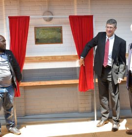 Unveiling the plaque of the new Umkhuleko School outside Pietermaritzburg are from left, Prince Xolani Zondi from the Inadi Royal Family, Michael Sacke, Isuzu Motors South Africa CEO and MD and Colin Cowie, Isuzu ChildLife Foundation chairman.