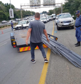 Trailer carrying steel rods breaks loose on M1 North
