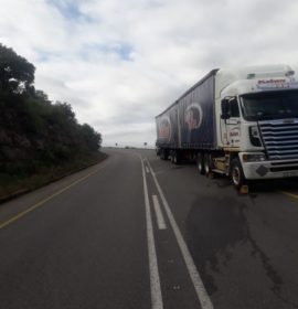 Stationary truck standing in the roadway on the R36
