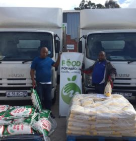 Trucklogix truck drivers, Victor Mtonga (left) and Melikhaya Joni show some of the food load which they transported from Johannesburg