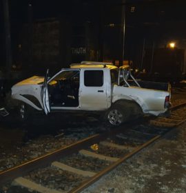 Driver injured after crashing into a log train at the Vryheid East Transnet Depot.