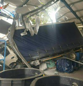 Driver seriously injured after truck crashes through a factory roof